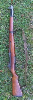 M1 Garand rifle laying in the grass