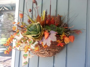 A basket of fall flowers brightens an autumn day.  Photo (c) Karen Hammond