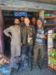 Selfie with the shop owner in Kashmir. I stopped here because I got lost and really needed a drink. Turns out I went 250 km the wrong way on my bike. Ow well. Photo © Karl Rock.