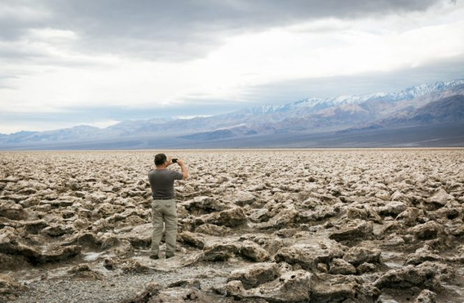Tourist in Badwater, Death Valley National Park