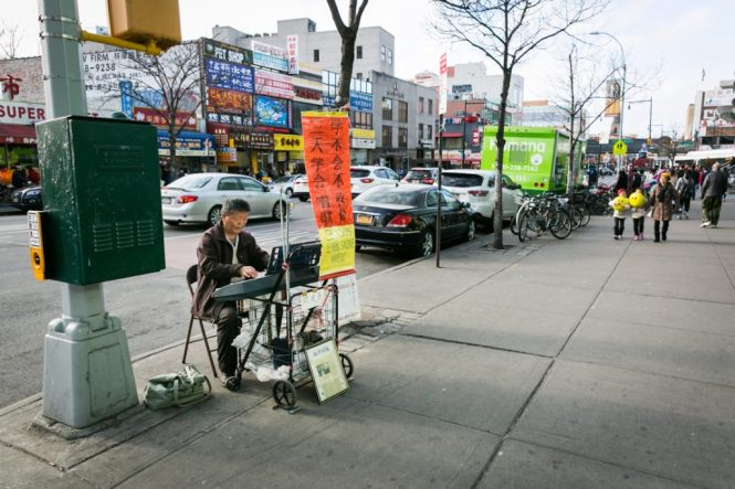 Piano player on the sidewalk in Flushing Queens street photography series