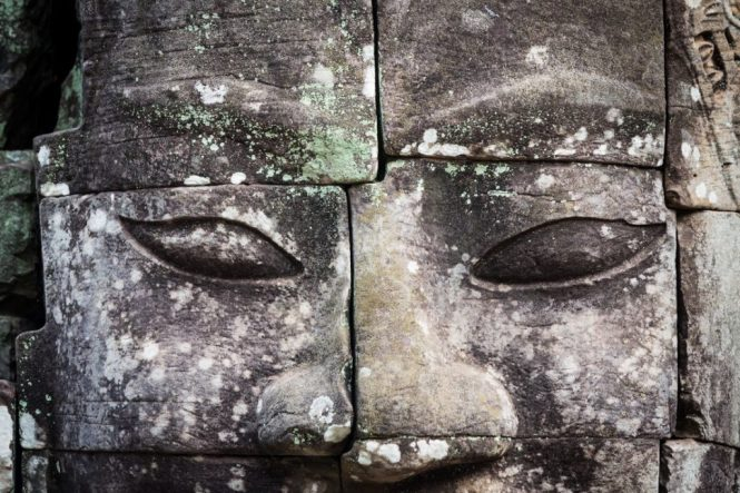 Close up of face at Bayon Temple for an Angkor Wat temple guide