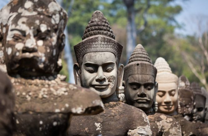 Line of statue heads at Bayon Temple for an article on Angkor Wat travel tips