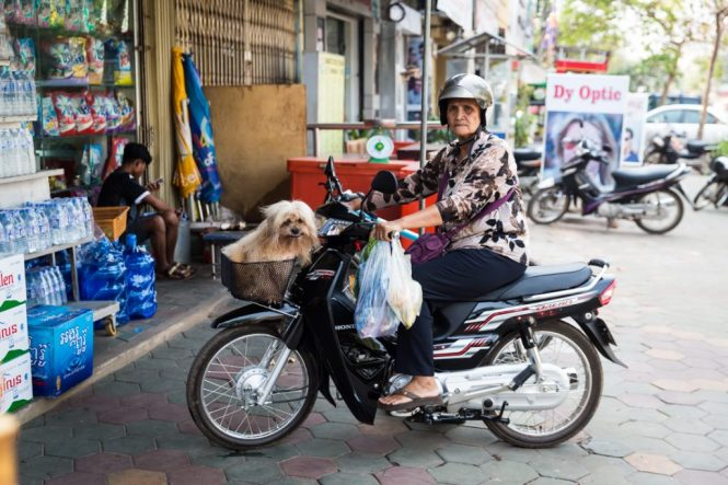 Woman on motor bike for an article on Siem Reap travel tips