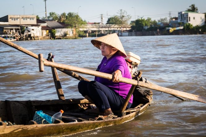 Women driving boat at the Cai Rang Floating Markets