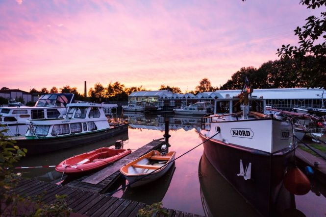Boats on a canal at sunset in Papenburg, Germany
