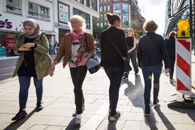 Women walking down street in Hamburg, Germany