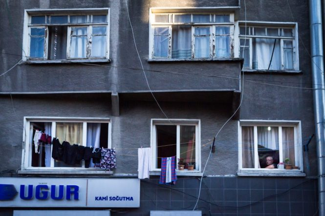 Man in window for an article on Istanbul street photos