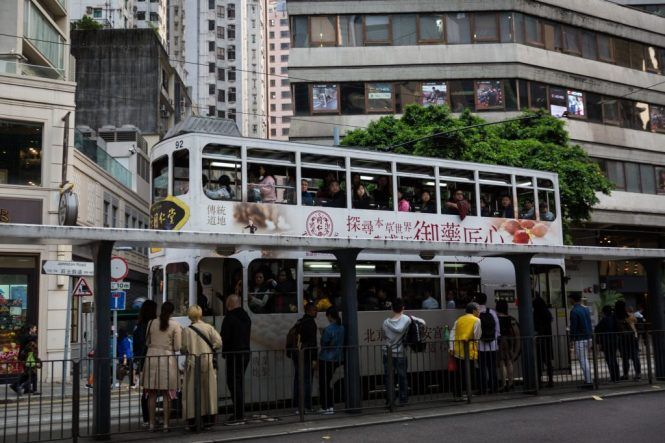 People getting on the ding ding for a Hong Kong street photography series called the view from the ding ding