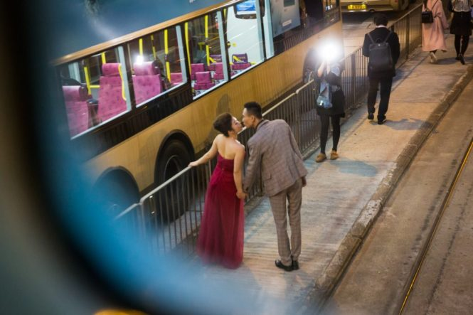 Couple kissing at ding ding station for a Hong Kong street photography series called the view from the ding ding