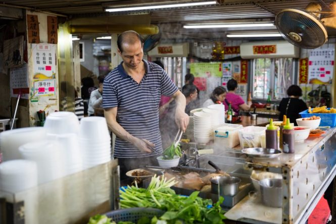 Cook preparing soup for a Hong Kong travel guide article