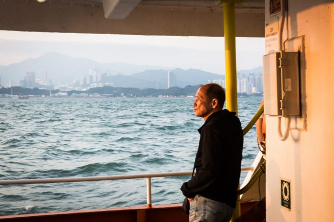 Man on ferry for a Hong Kong travel guide article