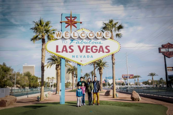 Family in front of the Las Vegas sign
