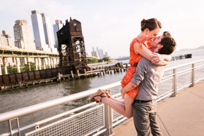Man lifting up woman for an article on best engagement photos