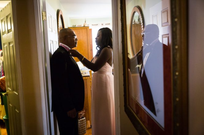 Father of the bride putting on tie for a Glen Terrace wedding
