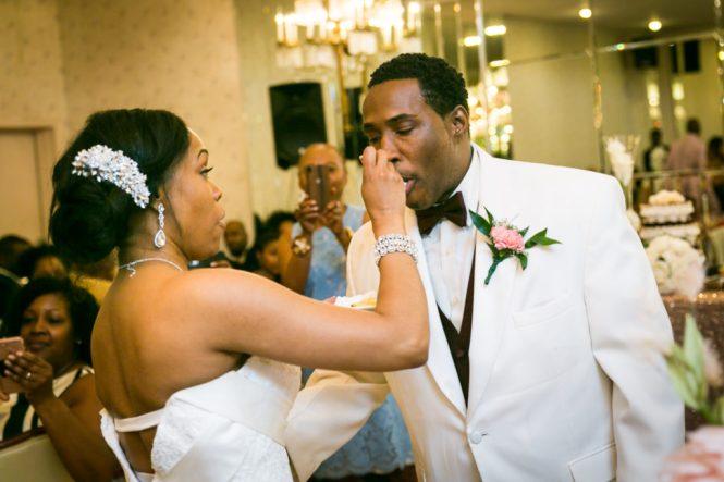 Bride feeding cake to groom at a Glen Terrace wedding