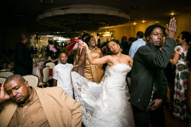 Bride in a line dance at a Glen Terrace wedding