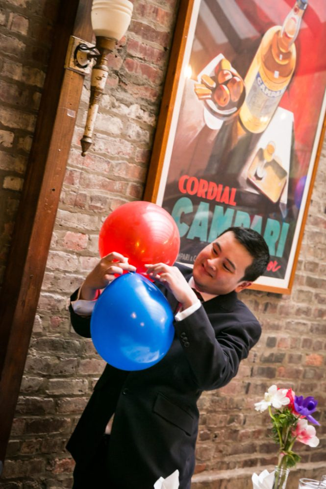 Guest helping with balloons at a Scottadio wedding
