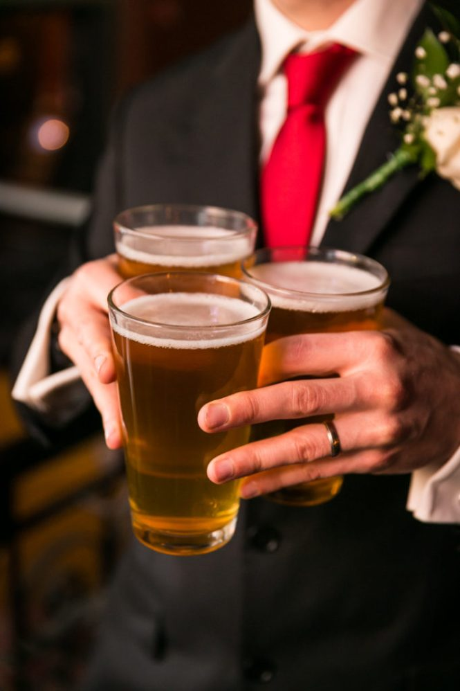 Wedding guest with beer at Union Hall in Brooklyn