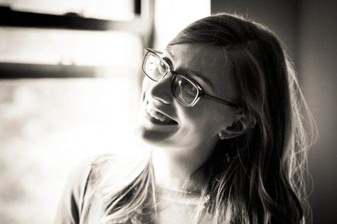 Smiling woman for a Fort Tryon Park engagement portrait
