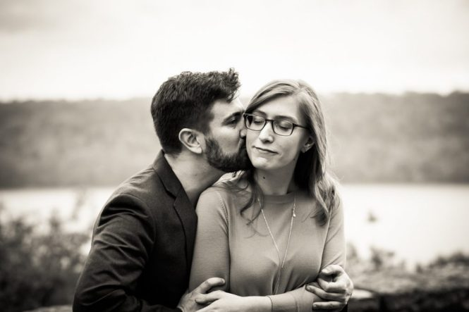 Kissing couple at a Fort Tryon Park engagement portrait