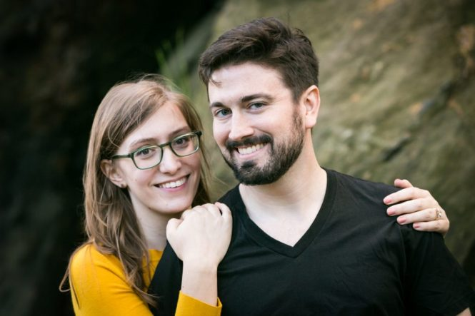 Smiling couple at a Fort Tryon Park engagement portrait