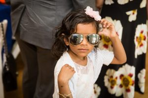 Kid with sunglasses by bar mitzvah photographer, Kelly Williams