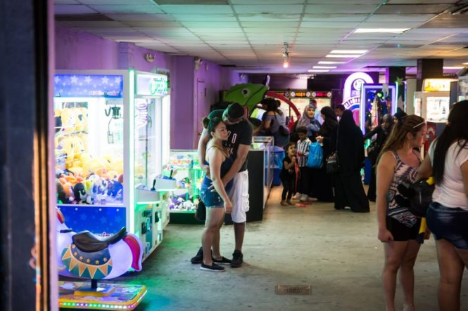 Lovers embracing at a Coney Island arcade