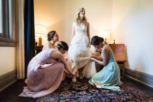 Bride getting into shoes before a Gallow Green wedding