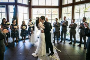 Bride and groom kissing for an article on wedding officiant tips