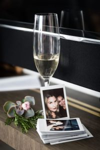 Glass of champagne and polaroids for a 26 Bridge wedding