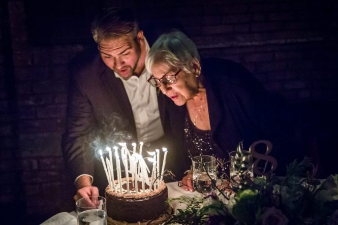 Grandmother and birthday cake at a 26 Bridge wedding