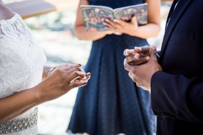 Bride and groom exchanging rings for an article on elopement tips