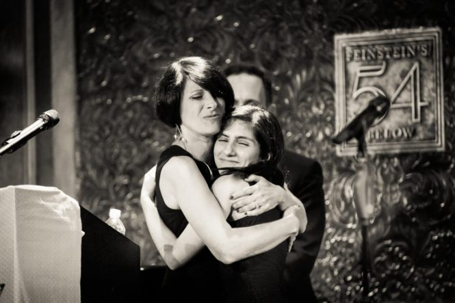 Mother hugging daughter at a bat mitzvah for an article on 'How to Find a Venue'