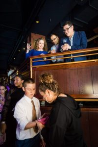 Wax hand station at a bat mitzvah for an article on 'How to Find a Venue'