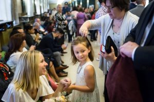 Flower girl having hair brushed for an article on How to Get Married at City Hall in Any NYC Borough