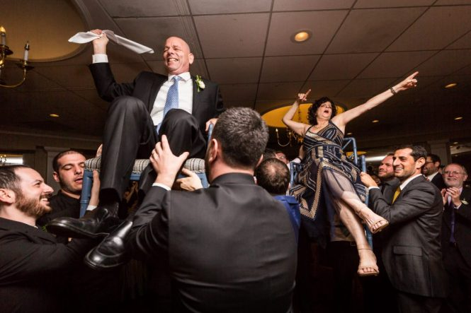 Parents dancing hora at a Larchmont Shore Club wedding