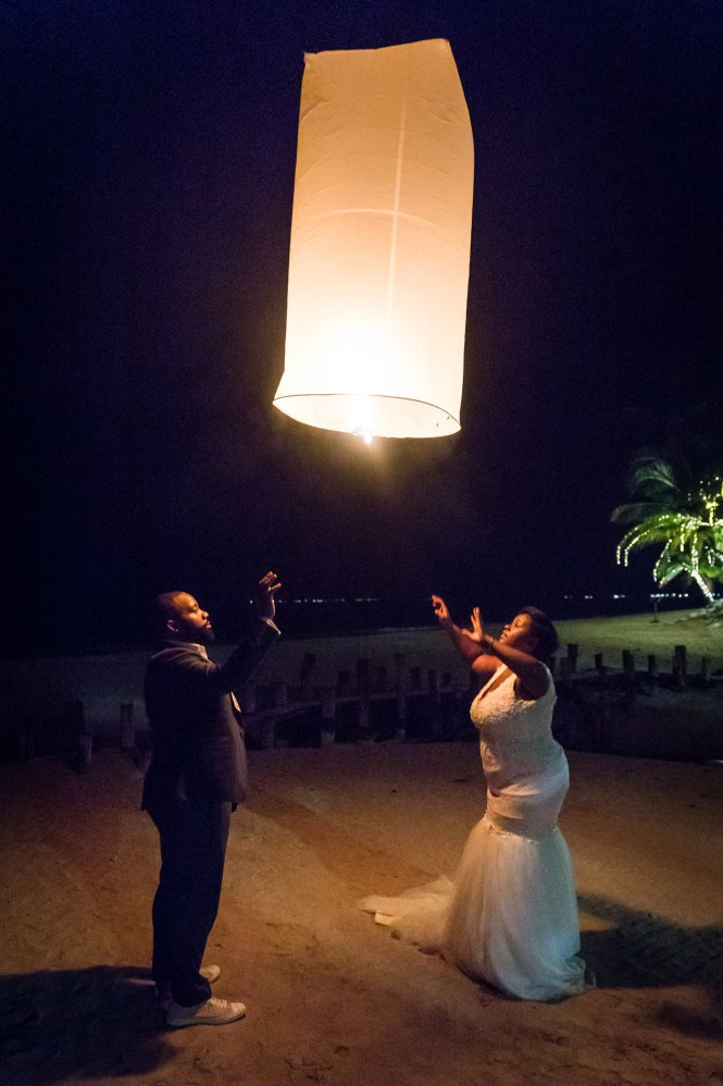 Bride and groom with lantern for an article on destination wedding photography tips