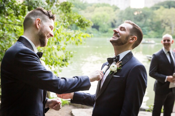 Grooms lint rolling each other for an article entitled, 'Do you need a permit to get married in Central Park?'