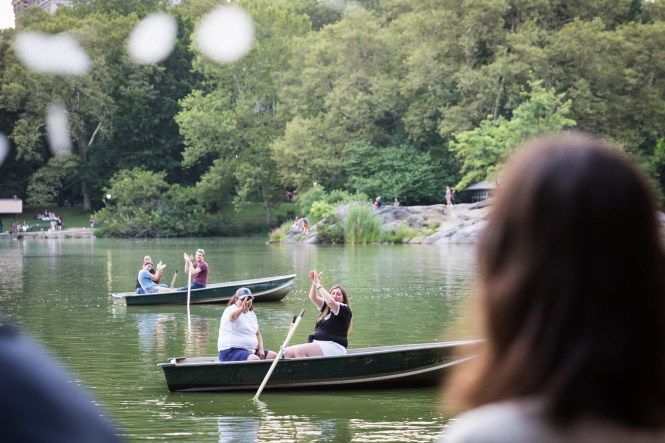 Boaters in Central Park lake clapping for an article entitled, 'Do you need a permit to get married in Central Park?'