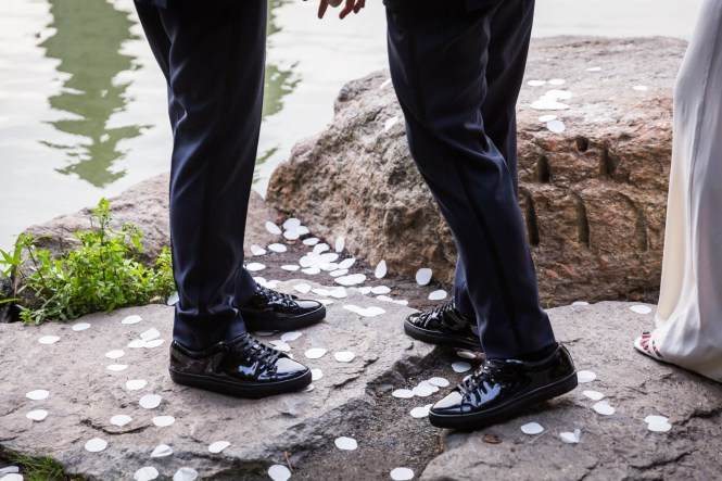Grooms wearing matching patent leather shoes for an article entitled, 'Do you need a permit to get married in Central Park?'