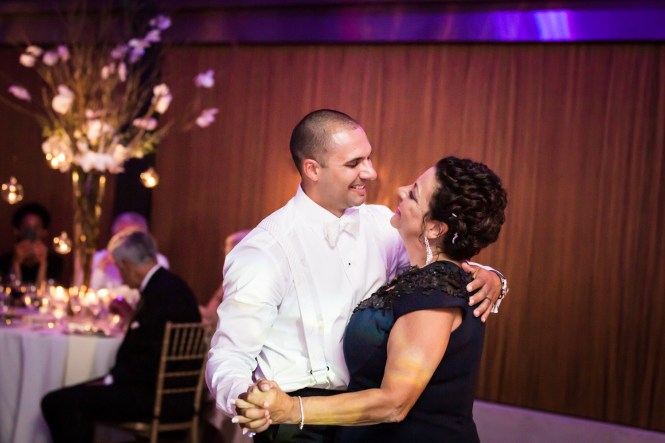 Groom and mother dancing for an article on Bronx Zoo wedding venue updates