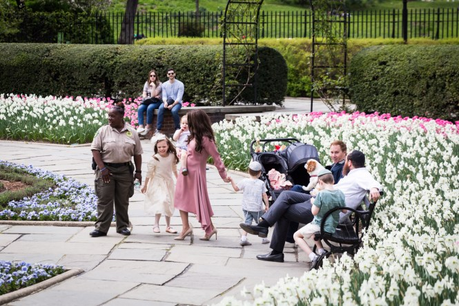 Central Park Conservatory Garden visitors and security guard
