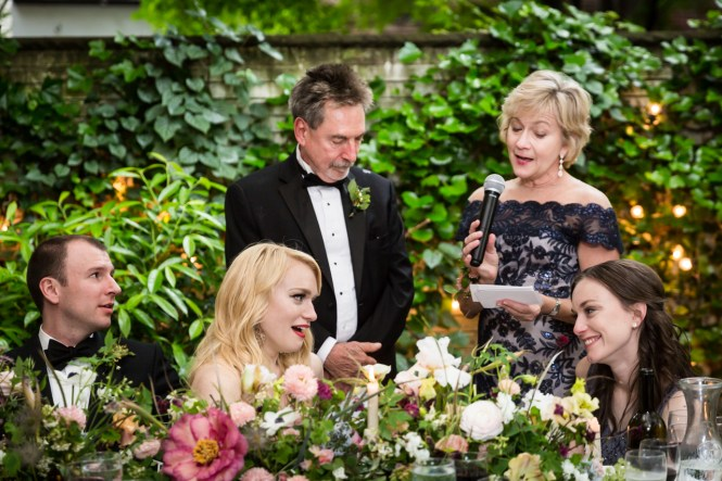 Parents giving toast to bride and groom at a Central Park Conservatory Garden wedding