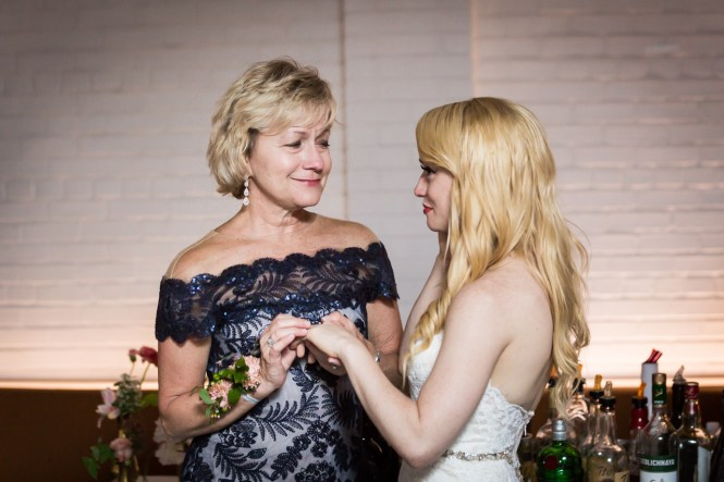 Mother and bride looking at ring at a Central Park Conservatory Garden wedding