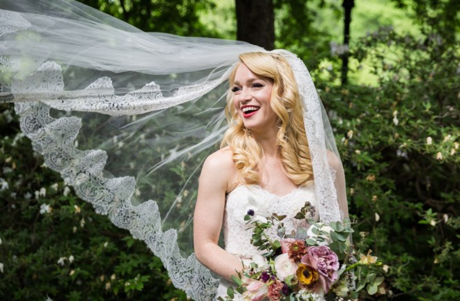 Bride with flowing veil at a Central Park Conservatory Garden wedding