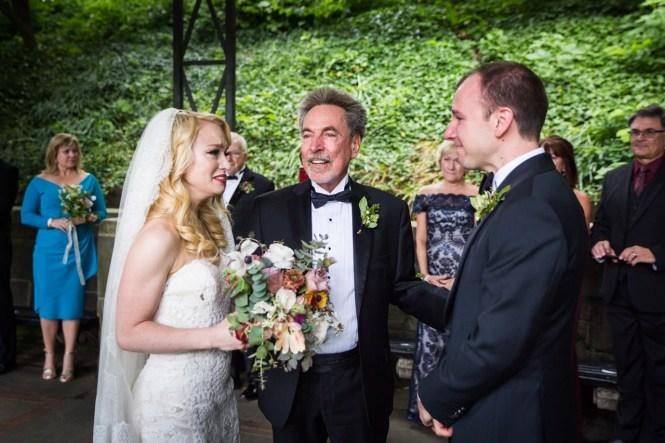Father giving away bride at a Central Park Conservatory Garden wedding