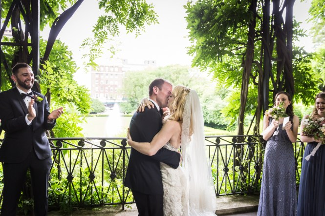 Bride and groom kissing at a Central Park Conservatory Garden wedding