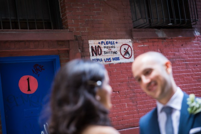 Vulgar sign in NYC alleyway for an article on non-floral centerpiece ideas