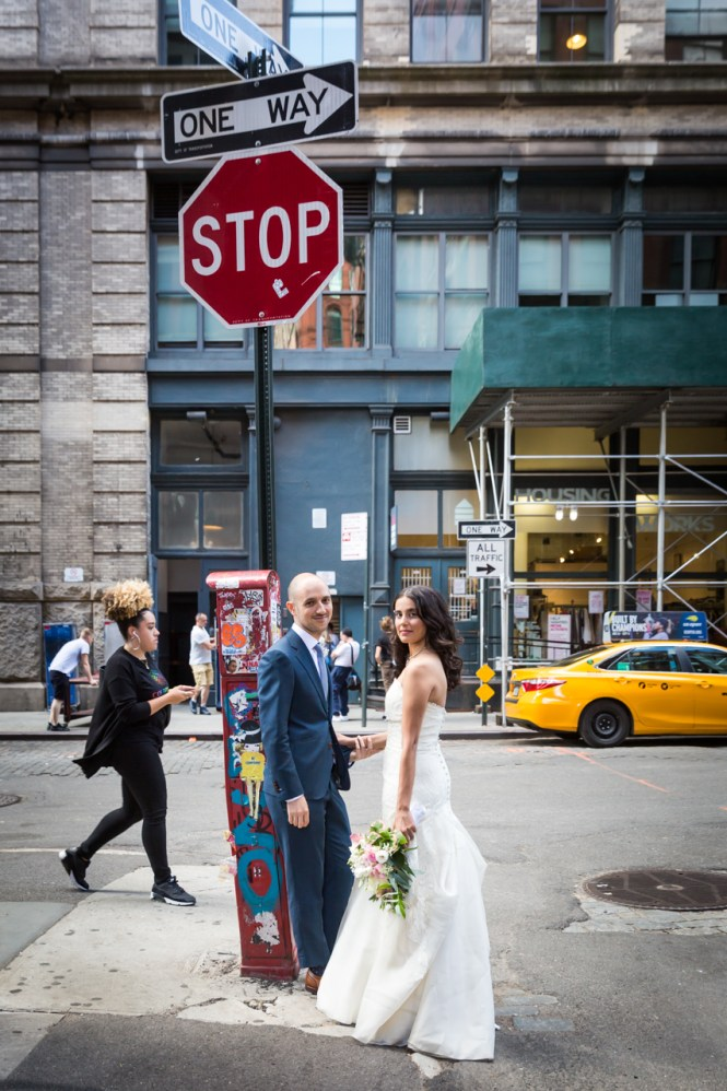 Bride and groom by stop sign for an article on non-floral centerpiece ideas
